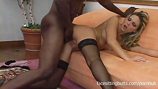 A blond housewife in stockings fucks her black step son