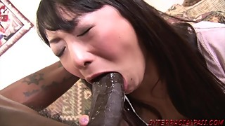 Asian wife takes on the big dick of a black swallow, big black dick cum