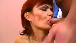 Red head granny sharing a fresh cock