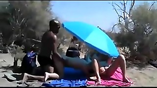 White wife sucks a strangers big black cock on beach in front of the other