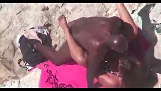 Hubby films wife cheating with black cock on the beach